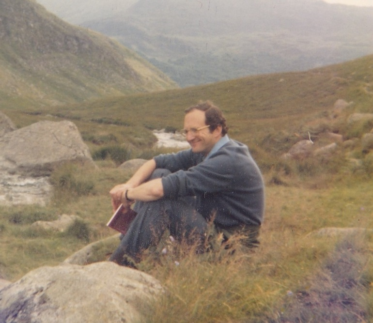 pops-with-book-on-hillside